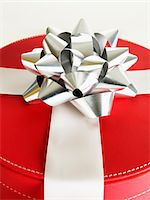 silver box - Red gift box with silver bow, close-up Stock Photo - Premium Royalty-Freenull, Code: 6106-05508258