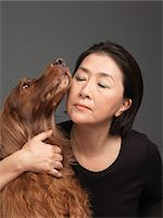 Mature woman with dog, close-up Stock Photo - Premium Royalty-Freenull, Code: 6106-05508396
