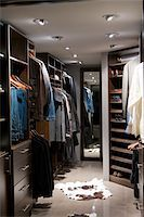 Walk-in closet with clothes in modern home Stock Photo - Premium Royalty-Freenull, Code: 6106-05508471
