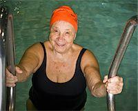 seniors and swim cap - Elderly woman climbing out of swimming pool Stock Photo - Premium Royalty-Freenull, Code: 6106-05508780