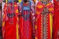 Three Masai Mara women in traditional clothing, mid section Stock Photo - Premium Royalty-Freenull, Code: 6106-05508871