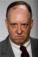 sweaty businessman - Man sweating, portrait Stock Photo - Premium Royalty-Freenull, Code: 6106-05509238