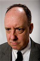 sweaty businessman - Man sweating, studio shot, close-up Stock Photo - Premium Royalty-Freenull, Code: 6106-05509242