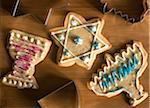 Cookies for Hanukah in shapes of kiddush cup, star of David and menorah Stock Photo - Premium Royalty-Free, Artist: Mark Burstyn, Code: 6106-05510531