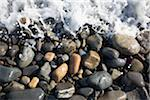 Surf splashes over stones on beach Stock Photo - Premium Royalty-Free, Artist: Aurora Photos, Code: 6106-05510771