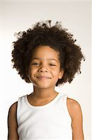 Portrait of young girl (4-5) in tank top, smiling Stock Photo - Premium Royalty-Freenull, Code: 6106-05511185