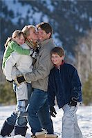 preteen kissing - Family with two children (8-10) in mountains Stock Photo - Premium Royalty-Freenull, Code: 6106-05511874
