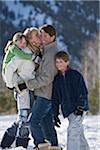 Family with two children (8-10) in mountains Stock Photo - Premium Royalty-Freenull, Code: 6106-05511874
