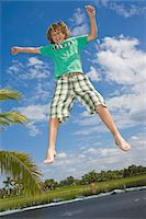 Portrait of boy (12-13) leaping, outdoors Stock Photo - Premium Royalty-Freenull, Code: 6106-05512398