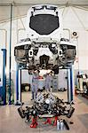 Mechanics working on car in garage Stock Photo - Premium Royalty-Free, Artist: Blend Images, Code: 649-05521261