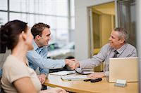 services - Couple shaking hands with car salesman Stock Photo - Premium Royalty-Freenull, Code: 649-05521318