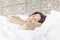 Woman asleep in bed Stock Photo - Premium Royalty-Freenull, Code: 649-05521562