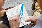 Close up of older couple with city map Stock Photo - Premium Royalty-Freenull, Code: 649-05521947