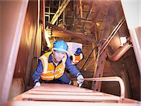 Engineer climbing staircase in ship Stock Photo - Premium Royalty-Freenull, Code: 649-05522193