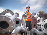 pipe (industry) - Businessman on shipbuilding site Stock Photo - Premium Royalty-Freenull, Code: 649-05522209