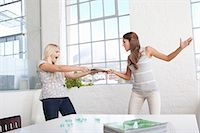 Businesswomen fighting over papers Stock Photo - Premium Royalty-Freenull, Code: 649-05522435