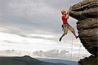 rock climber - Rock climber scaling steep rock face Stock Photo - Premium Royalty-Freenull, Code: 649-05522624