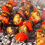 Chicken tikka kebabs on grill Stock Photo - Premium Royalty-Free, Artist: Flowerphotos, Code: 649-05522663