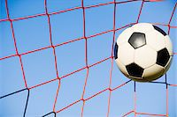 Football in goal Stock Photo - Premium Royalty-Freenull, Code: 614-05522921