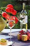 White wine, gift and bunch of tulips on garden table Stock Photo - Premium Rights-Managed, Artist: F1Online, Code: 853-05523461