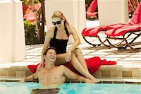 Couple at Swimming Pool Stock Photo - Premium Royalty-Freenull, Code: 600-05524089