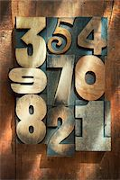 Wooden Letterpress Numbers Stock Photo - Premium Royalty-Freenull, Code: 600-05524423