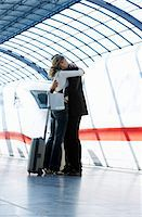 platform - Couple embracing on train station platform, side view Stock Photo - Premium Royalty-Freenull, Code: 6106-05525136