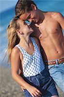 Girl and boy (8-11) on beach Stock Photo - Premium Royalty-Freenull, Code: 6106-05530617