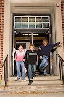 Children (8-10) running down stairway outside entrance of school Stock Photo - Premium Royalty-Freenull, Code: 6106-05532126