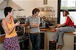 Three friends in kitchen Stock Photo - Premium Royalty-Free, Artist: Aurora Photos            , Code: 6106-05532961
