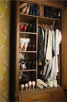 Clothing and shoes in closet Stock Photo - Premium Royalty-Freenull, Code: 6106-05533273