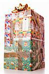 Large gift wrapped with different Christmas wrapping papers