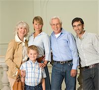 Three generational family, indoors, smiling, portrait Stock Photo - Premium Royalty-Freenull, Code: 6106-05537946
