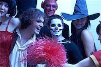 Group of people dressed for Halloween, smiling, portrait Stock Photo - Premium Royalty-Freenull, Code: 6106-05538394