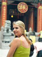 China, Hong Kong, woman by Wong Tai Sin Taoist Temple, smiling Stock Photo - Premium Royalty-Freenull, Code: 6106-05540015