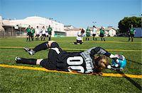 preteen girls stretching - Female goalie (12-14) saving penalty, rear view Stock Photo - Premium Royalty-Freenull, Code: 6106-05540077