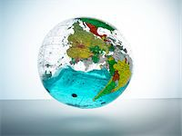 Globe with water inside Stock Photo - Premium Royalty-Freenull, Code: 6106-05540350