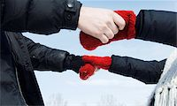 Couple holding hands, close-up Stock Photo - Premium Royalty-Freenull, Code: 6106-05543002