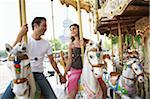 France, Paris, couple riding carousel, holding hands Stock Photo - Premium Royalty-Freenull, Code: 6106-05543818