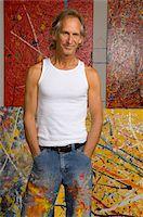 slim - Mature man standing in painting studio, smiling, portrait Stock Photo - Premium Royalty-Freenull, Code: 6106-05545280