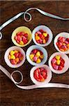 Heart shape candy inside cupcake holders Stock Photo - Premium Royalty-Free, Artist: I Dream Stock, Code: 6106-05546356