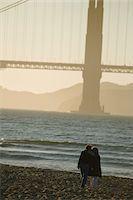USA, California, San Francisco, couple walking on beach, sunset Stock Photo - Premium Royalty-Freenull, Code: 6106-05547499