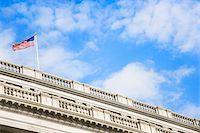 represented - USA, Washington, DC, American flag atop building, low angle view Stock Photo - Premium Royalty-Freenull, Code: 6106-05548046