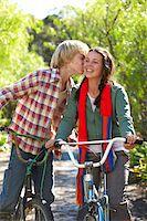 Teenage boy kissing girl (13-15) on cheek, outdoor Stock Photo - Premium Royalty-Freenull, Code: 6106-05548084