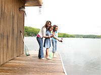 Mother and daughters (8-10) fishing Stock Photo - Premium Royalty-Freenull, Code: 6106-05548300