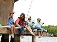 Parents and daughters (8-10) fishing from dock Stock Photo - Premium Royalty-Freenull, Code: 6106-05548305