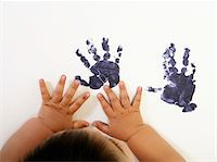 finger painting - Baby boy (15-18 months) making painted hand prints, close-up Stock Photo - Premium Royalty-Freenull, Code: 6106-05548551