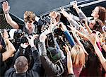 Celebrity waving to paparazzi and fans Stock Photo - Premium Royalty-Free, Artist: Blend Images, Code: 635-05550031