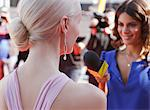 Celebrity speaking to reporter on red carpet Stock Photo - Premium Royalty-Free, Artist: Bryan Reinhart, Code: 635-05550041