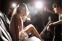 Celebrities emerging from car towards paparazzi Stock Photo - Premium Royalty-Freenull, Code: 635-05550046